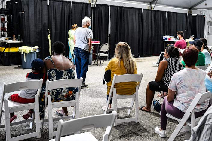 Patients wait for their treatment inside the Regeneron Clinic at a monoclonal antibody treatment site in Pembroke Pines, Florida, on August 19, 2021. - Florida Governor Ron DeSantis announced the opening of the Covid-19 antibody treatment site. DeSantis continues to promote the monoclonal antibody treatments as cases and hospitalizations spike in Florida. Starting Wednesday, C.B. Smith Park will start offering the antibody treatment from 9 a.m. to 5 p.m. seven days a week. The site will be able to treat over 300 patients a day. (Photo by CHANDAN KHANNA / AFP) (Photo by CHANDAN KHANNA/AFP via Getty Images)