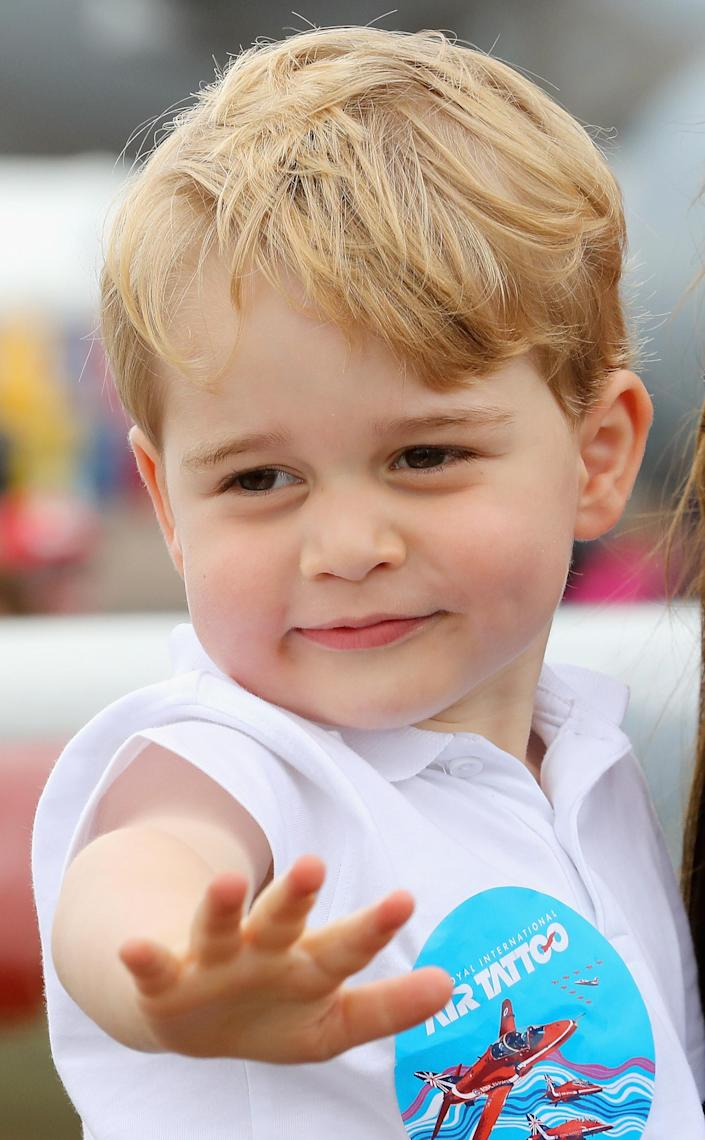 Prince George waving a visit to the Royal International Air Tattoo at RAF Fairford in 2016. (Getty Images)