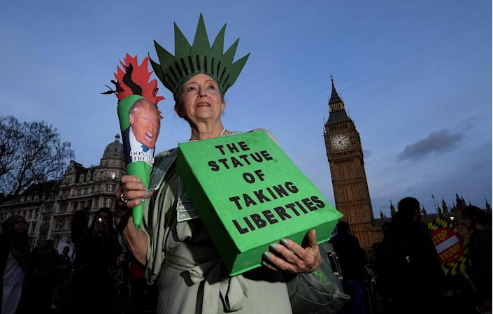 <p>A demonstrator dressed as the Statue of Liberty takes part in a protest against U.S. President Donald Trump in London, Feb. 20, 2017. (Photo: Toby Melville/Reuters) </p>