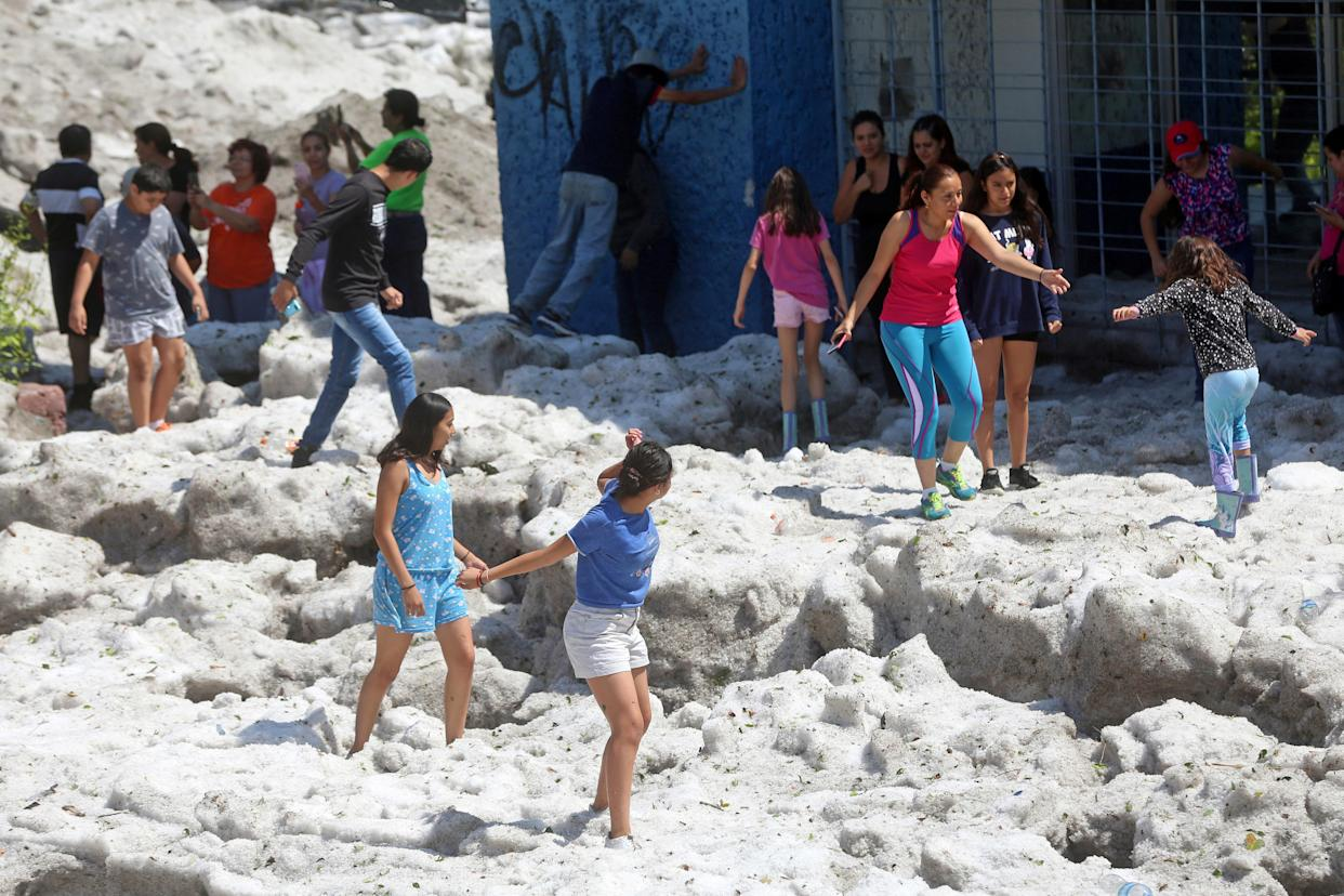 Residents play on top of hail in Guadalajara, Mexico, on June 30. (Photo: Fernando Carranza/Reuters)
