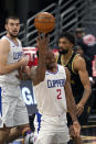 Los Angeles Clippers forward Kawhi Leonard (2) throws up a shot after getting fouled by Toronto Raptors center Khem Birch (24) during the second half of an NBA basketball game Tuesday, May 11, 2021, in Tampa, Fla. (AP Photo/Chris O'Meara)