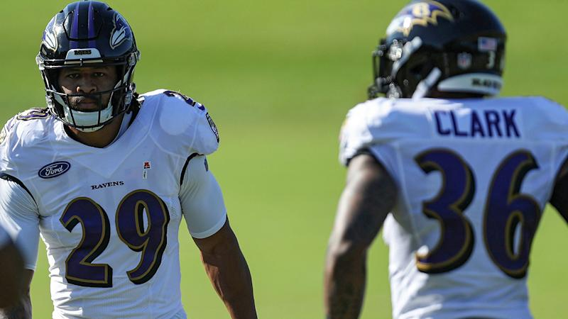 Earl Thomas III, left, and Chuck Clark, right, are pictured during the Baltimore Ravens' training camp.