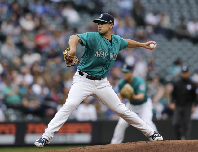 Seattle Mariners starting pitcher Marco Gonzales works against the Kansas City Royals during the first inning of a baseball game Friday, June 29, 2018, in Seattle. (AP Photo/John Froschauer)