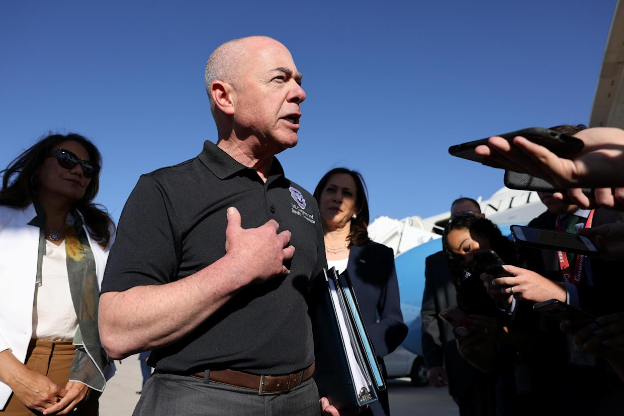 Department of Homeland Security Secretary Alejandro Mayorkas, flanked, right, by Vice President Kamala Harris and, left, by Rep. Veronica Escobar, D-Texas, talks to the media in El Paso, Texas, in June.