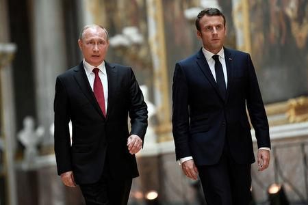 After meeting Assad ally Putin, Macron meets Syrian opposition