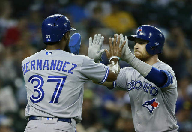 Toronto Blue Jays' Brandon Drury celebrates with Teoscar Hernandez (37) after hitting a two-run home run against the Detroit Tigers during the sixth inning of a baseball game, Saturday, July 20, 2019, in Detroit. (AP Photo/Duane Burleson)