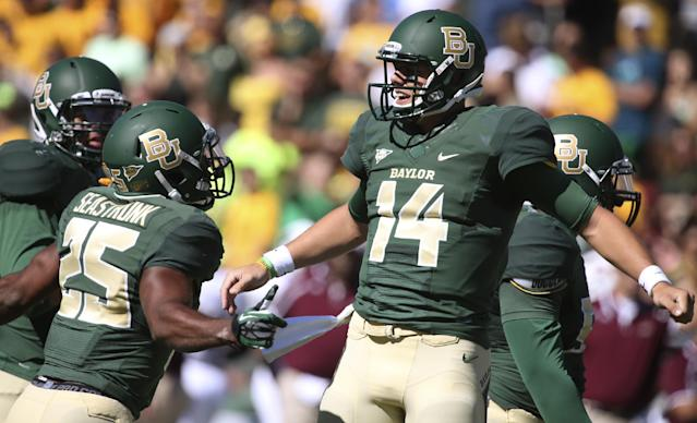 Baylor quarterback Bryce Petty (14) celebrates his touchdown against Louisiana-Monroe with teammate Lache Seastrunk (25) during the first half of an NCAA college football game, Saturday, Sept. 21, 2013, in Waco, Texas. (AP Photo/Waco Tribune Herald, Rod Aydelotte)