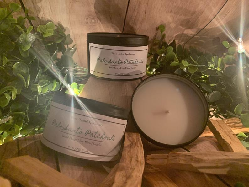 """<p><strong>BlkOrchidApothecary</strong></p><p>etsy.com</p><p><strong>$12.75</strong></p><p><a href=""""https://go.redirectingat.com?id=74968X1596630&url=https%3A%2F%2Fwww.etsy.com%2Flisting%2F815064256%2Fpalo-santo-patchouli-candle&sref=https%3A%2F%2Fwww.redbookmag.com%2Flife%2Fg36819290%2Fblack-owned-candle-companies%2F"""" rel=""""nofollow noopener"""" target=""""_blank"""" data-ylk=""""slk:Shop Now"""" class=""""link rapid-noclick-resp"""">Shop Now</a></p><p>If you're a fan of warm, woodsy scents, cozy up to this scent that's perfect for yoga, meditation, and any food show on Netflix, IMO. </p>"""
