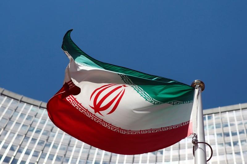 An Iranian flag flutters in front of the UN headquarters in Vienna