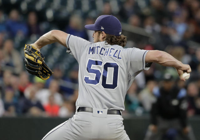 San Diego Padres starting pitcher Bryan Mitchell throws against the Seattle Mariners during the first inning of a baseball game, Tuesday, Sept. 11, 2018, in Seattle. (AP Photo/Ted S. Warren)