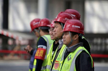 Workers are seen at the construction site of new Daxing Airport on the outskirts of Beijing, China October 16, 2017. REUTERS/Jason Lee