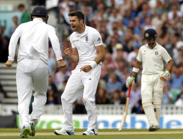 England's James Anderson (C) celebrates taking the wicket of India's Murali Vijay for two runs on the third day of the fifth Test at The Oval in London on August 17, 2014