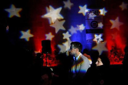People watch a broadcast of the U.S. presidential race between Democratic nominee Hillary Clinton and Republican nominee Donald Trump in a restaurant in Mexico City, Mexico November 9, 2016. REUTERS/Carlos Jasso