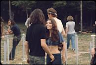 <p>Low-rise denim, as seen here on a woman at the Woodstock music festival.</p>