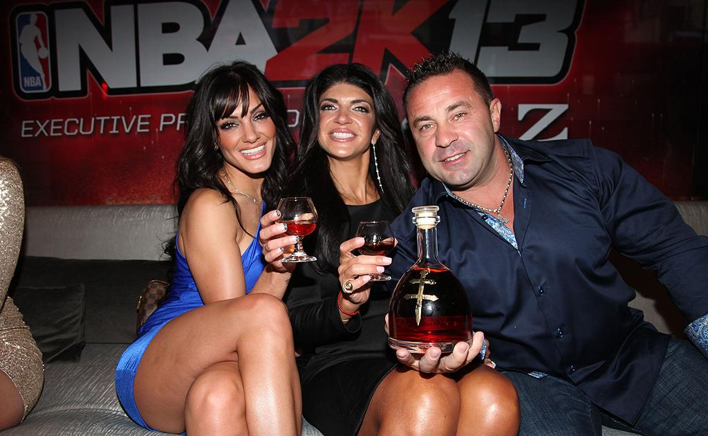 "She may be in the midst of a major catfight on ""The Real Housewives of New Jersey,"" but Teresa Giudice was all smiles as she partied with her husband, Joe Giudice, and makeup artist, Priscilla DiStasio. (9/26/12)"