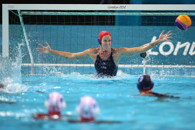 LONDON, ENGLAND - AUGUST 01: Betsey Armstrong of the USA blocks a Spain attack on Day 5 of the London 2012 Olympics at Water Polo Arena on August 1, 2012 in London, England. (Photo by Jeff J Mitchell/Getty Images)