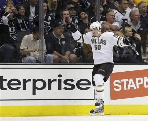 Dallas Stars' Antoine Roussel, of France, celebrates his goal against the Los Angeles Kings during the second period of an NHL hockey game in Los Angeles, Sunday, April 21, 2013. (AP Photo/Jae C. Hong)