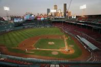 The Boston Red Sox play against the Tampa Bay Rays during the eighth inning of a baseball game at Fenway Park, Thursday, Aug. 13, 2020, in Boston. (AP Photo/Michael Dwyer)