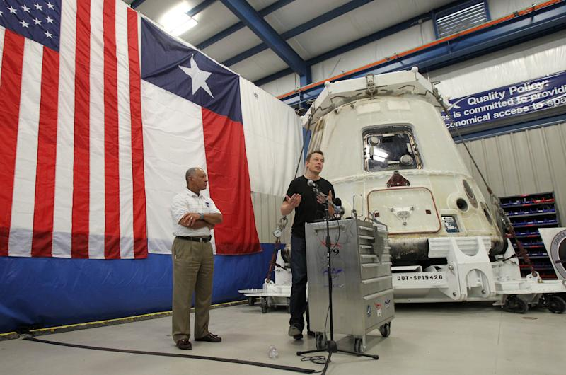 NASA Administrator Charles Bolden, left, and SpaceX CEO Elon Musk, right, stand in front of the SpaceX Dragon spacecraft Wednesday June 13, 2012 at the SpaceX Rocket Development Facility in McGregor, Texas. The spacecraft recently made history as the first commercial vehicle to visit the International Space Station. The California-based SpaceX is the first private business to send a cargo ship to the space station. (AP Photo/Waco Tribune-Herald, Duane A. Laverty)