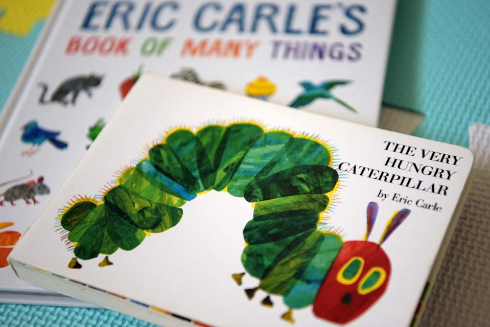 Eric Carle's 'The Very Hungry Caterpillar' and 'Book of Many Things' (AFP via Getty Images)