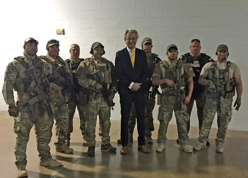 Members of a US SWAT team posing for a photo with Geert Wilders (C) prior to the US Mohammed Art Exhibit on May 3, 2015 at the Curtis Culwell Center in Garland, Texas (AFP Photo/)