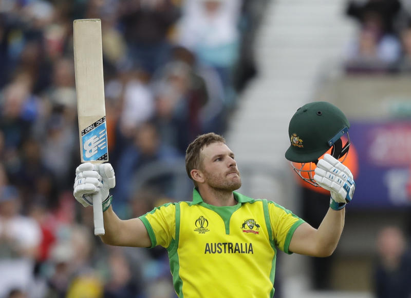 Australia's captain Aaron Finch celebrates scoring a century during the World Cup cricket match between Sri Lanka and Australia at The Oval in London, Saturday, June 15, 2019. (AP Photo/Kirsty Wigglesworth)