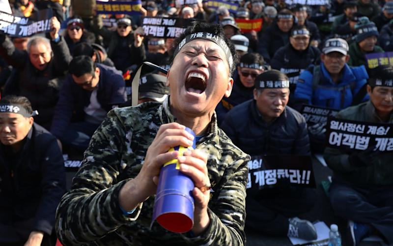 South Korean taxi drivers participate in a rally calling for the car-pooling app to be banned in front of the National Assembly on December 20, 2018 in Seoul - Getty Images AsiaPac