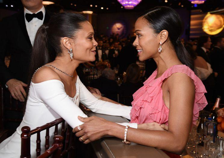 Thandie Newton and Zoe Saldana catch up. (Photo: Getty Images)