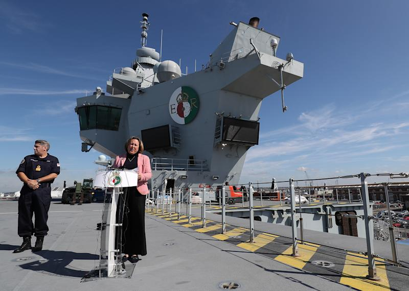Minister for Defence Procurement Anne-Marie Trevelyan, gives a speech on the flight deck of HMS Queen Elizabeth, as she prepares to sail to sail to the United States for Westlant 19, where British F35s will take part in trials.