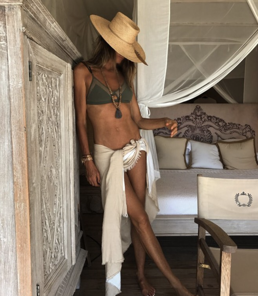 <p>Elle Macpherson, 54, shows off her abs in a hunter green bikini and low-slung sarong. (Photo: Instagram/Elle Macpherson) </p>