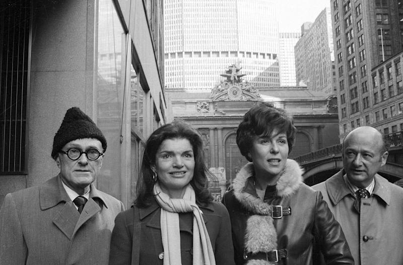 """FILE - In this Jan. 30, 1975, file photo, Jacqueline Kennedy Onassis, center left, and Bess Myerson, center right, walk with architect Philip Johnson, left, and Rep. Ed Koch, right, as they leave New York's Grand Central after holding a news conference for the """"Committee to Save Grand Central Station."""" Koch, the combative politician who rescued the city from near-financial ruin during three City Hall terms, has died at age 88. Spokesman George Arzt says Koch died Friday morning Feb. 1, 2013 of congestive heart failure. (AP Photo/Harry Harris, File)"""