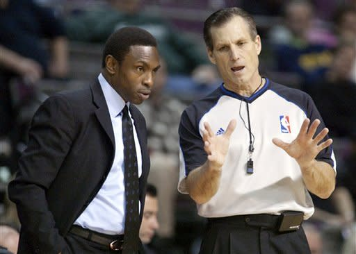 New Jersey Nets coach Avery Johnson, left, listens to NBA official Greg Willard in the second half of an NBA basketball game against the Detroit Pistons, Friday, Feb. 10, 2012, in Auburn Hills, Mich. The Pistons defeated the Nets 109-92. (AP Photo/Duane Burleson)