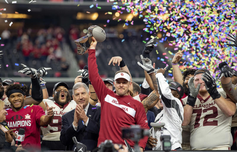 Oklahoma head coach Lincoln Riley hoists the Big 12 Conference championship trophy after beating Texas 39-27 in the Big 12 Conference championship NCAA college football game on Saturday Dec. 1 2018 in Arlington Texas