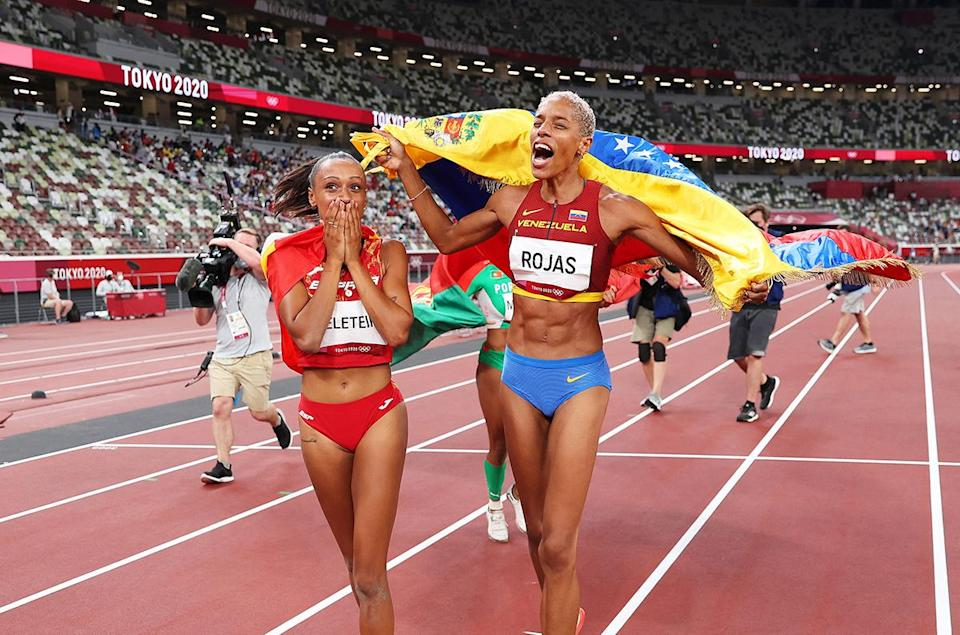 <p>Bronze medallist Ana Peleteiro of Spain and gold medallist Yulimar Rojas of Venezuela soak in their wins following the women's triple jump final at the Olympic Stadium on August 1.</p>
