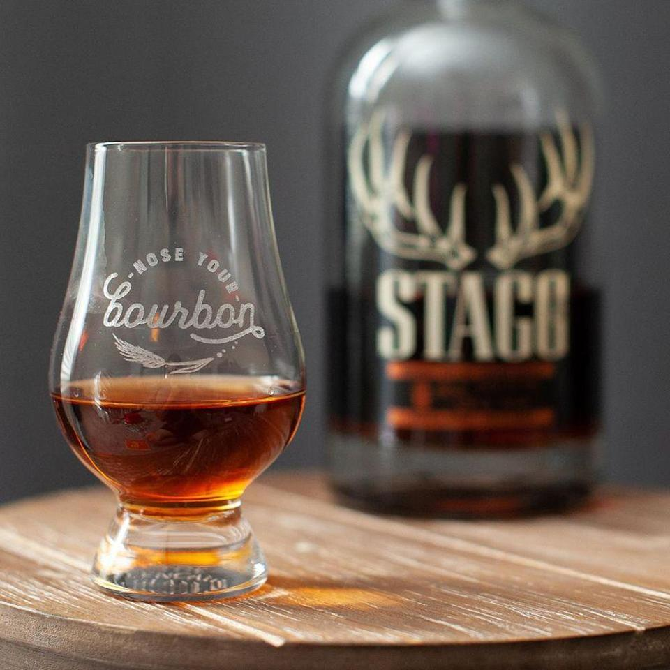 """<p><strong>NoseYourBourbon</strong></p><p>etsy.com</p><p><strong>$19.00</strong></p><p><a href=""""https://go.redirectingat.com?id=74968X1596630&url=https%3A%2F%2Fwww.etsy.com%2Flisting%2F834716676%2Fauthentic-glencairn-bourbon-whiskey&sref=https%3A%2F%2Fwww.bestproducts.com%2Feats%2Ffood%2Fg3171%2Fbest-whiskey-gifts%2F"""" rel=""""nofollow noopener"""" target=""""_blank"""" data-ylk=""""slk:Shop Now"""" class=""""link rapid-noclick-resp"""">Shop Now</a></p><p>Any whiskey lover is likely already familiar with the <a href=""""https://coolmaterial.com/food-drink/history-glencairn-whiskey-glass/"""" rel=""""nofollow noopener"""" target=""""_blank"""" data-ylk=""""slk:Glencairn-style"""" class=""""link rapid-noclick-resp"""">Glencairn-style</a> glass which allows for optimal appreciation as you taste. We love that this glass is etched with a reminder to nose your bourbon before sipping.</p>"""