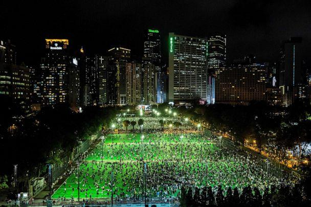 PHOTO: A candlelight vigil to commemorate the victims of the 1989 Tiananmen Square crackdown is held at Victoria Park in Hong Kong on June 4, 2020. (Isaac Lawrence/AFP via Getty Images)