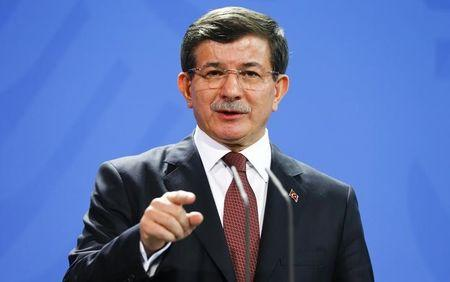 Turkish Prime Minister Davutoglu speaks to media after his meeting with German Chancellor Merkel at the Chancellery in Berlin