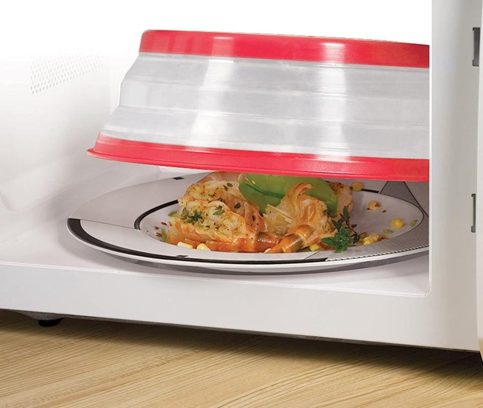 """It'll allow you to reheat leftovers to perfection while protecting your microwave from splatters.This BPA-free microwave cover is heat resistant up to 600 degrees. It's also dishwasher-safe for easy cleanup.<br /><br /><strong>Promising Review:</strong>""""This works wonderfully. I got tired of using paper towels. Half the time they would fall into the middle of the bowls, especially soup bowls, when heating them up in the microwave or we'd get splatters of sauce and other foods throughout the inside of the microwave so I decided to give this a try. It is cool and it pops out into three different sizes. There's no splatter, no mess, and it cleans up easily. I recommend this to anyone who uses paper towels to cover microwave dishes when heating up food. No more wasting tons of paper towels which are not cheap anymore."""" —<a href=""""https://www.amazon.com/gp/customer-reviews/R1R60MV2158LI5?&linkCode=ll2&tag=huffpost-bfsyndication-20&linkId=3ae04f52885b89a6c23e91328e70e56c&language=en_US&ref_=as_li_ss_tl"""" target=""""_blank"""" rel=""""noopener noreferrer"""">SteubenOhio</a><br /><br /><strong>Get it from Amazon for <a href=""""https://www.amazon.com/Tovolo-Vented-Collapsible-Microwave-Cover/dp/B000SOS7WG?&linkCode=ll1&tag=huffpost-bfsyndication-20&linkId=37572833ee6f7a7982460cc25689df60&language=en_US&ref_=as_li_ss_tl"""" target=""""_blank"""" rel=""""noopener noreferrer"""">$7.99+</a> (available in three colors).</strong>"""