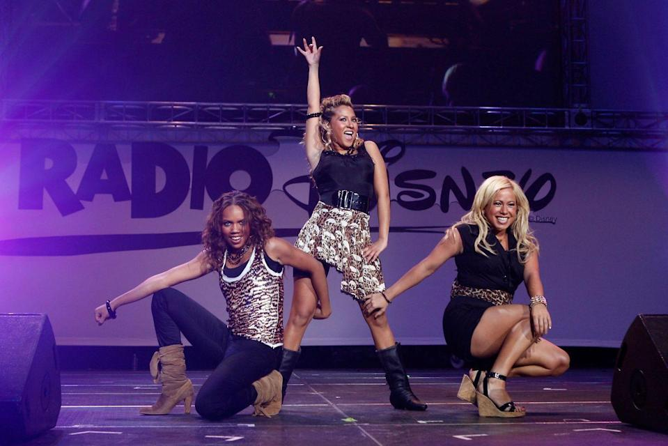 <p>In 2002, Disney put together a girl group for their Disney Channel original movie, <em>The Cheetah Girls</em>, featuring 3LW alums Adrienne Bailon and Kiely Williams, Sabrina Bryan, and Raven-Symoné<strong>. </strong>The movie was a hit and spawned multiple sequels, they produced three successful albums, and also had a YA book series and a clothing line. There were even dolls. Dolls! You know you've made it when you've got a doll that looks like you.</p>