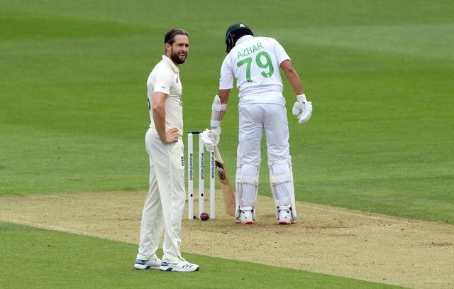 Chris Woakes cannot believe it after the ball hits the stumps but fails to dislodge the bails