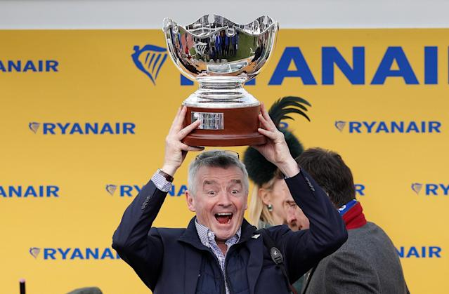 Horse Racing - Cheltenham Festival - Cheltenham Racecourse, Cheltenham, Britain - March 15, 2018 Ryanair Chief Executive Michael O'Leary celebrates with a trophy after winning the 14:50 Ryanair Chase REUTERS/Darren Staples