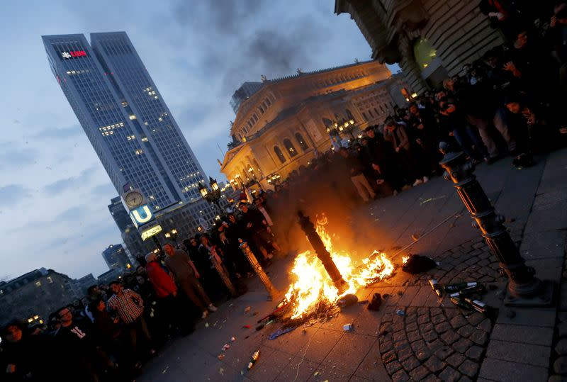 Protesters burn debris during an anti-capitalist demonstration in Frankfurt
