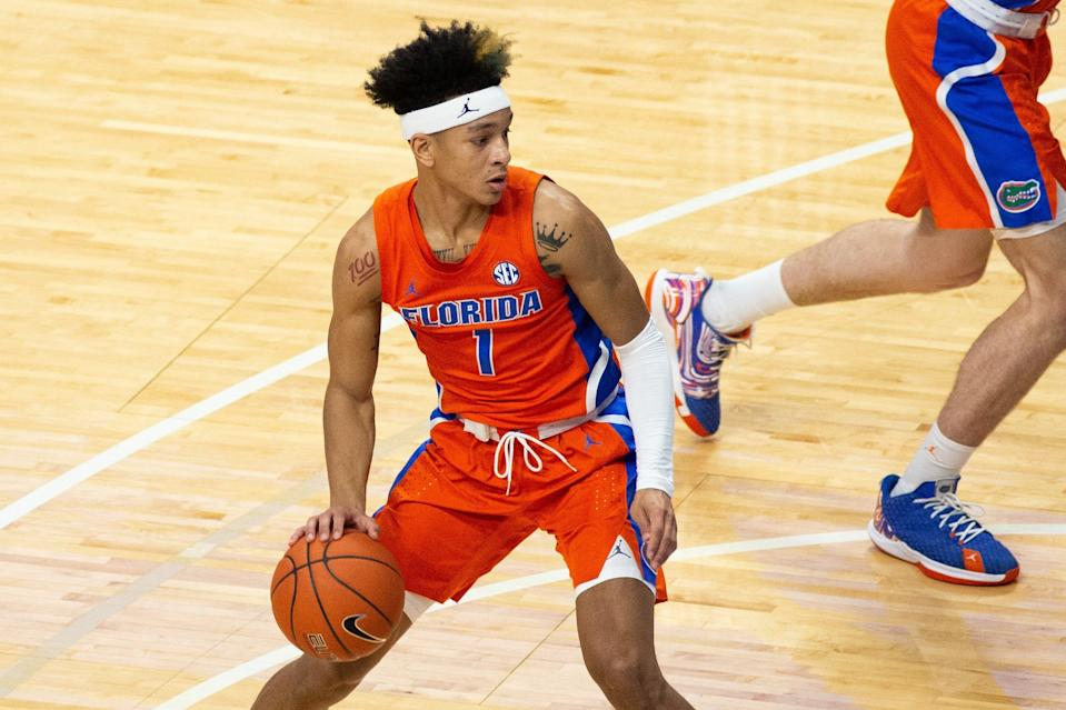 Feb 27, 2021; Lexington, Kentucky, USA; Florida Gators guard Tre Mann (1) during the first half of the game against the Kentucky Wildcats at Rupp Arena at Central Bank Center. Mandatory Credit: Arden Barnes-USA TODAY Sports ORG XMIT: IMAGN-439559 ORIG FILE ID:  20210302_ter_kt3_323.jpg