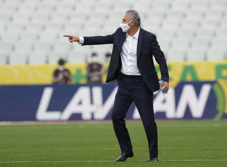 Brazil's coach Tite gestures as the qualifying soccer match for the FIFA World Cup Qatar 2022 game against Argentina is interrupted by health authorities at Neo Quimica Arena stadium in Sao Paulo, Brazil, Sunday, Sept.5, 2021. (AP Photo/Andre Penner)