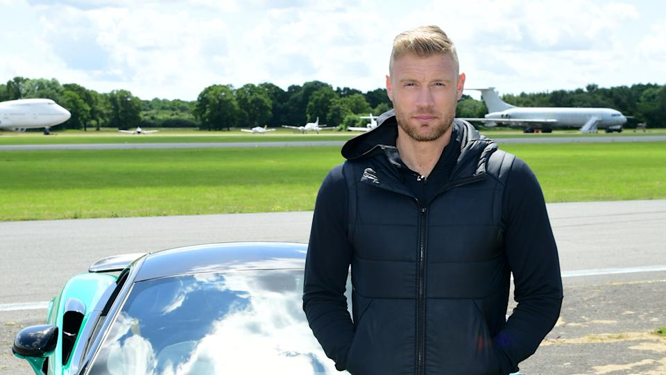 Freddie Flintoff poses next to a car on the 'Top Gear' test track. (Credit: PA)
