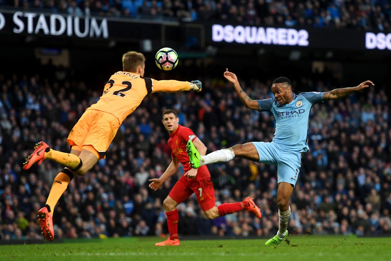 <p>Raheem Sterling and Simon Mignolet challenge for the ball </p>