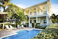 """<p>It doesn't get much more idyllic than a luxurious island of villas located a stone's throw from the hustle-and-bustle of Key West. <a href=""""https://www.sunsetkeycottages.com/"""" rel=""""nofollow noopener"""" target=""""_blank"""" data-ylk=""""slk:Sunset Key Cottages"""" class=""""link rapid-noclick-resp"""">Sunset Key Cottages</a> is considered by many to be the best resort in the Sunshine State for many reasons. Maybe it's the bougainvillea-laced cottages, award-winning restaurant, or unique personal touches, like breakfast baskets delivered to your door, that make this place beloved by visitors of all ages. </p>"""