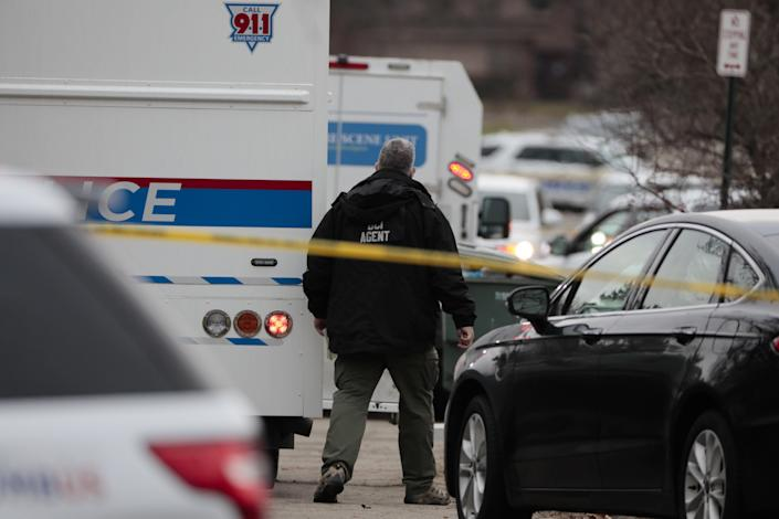 An Ohio Bureau of Criminal Investigation agent arrives at the scene of an officer-involved shooting on Tuesday, Dec. 22, 2020 in Columbus, Ohio.