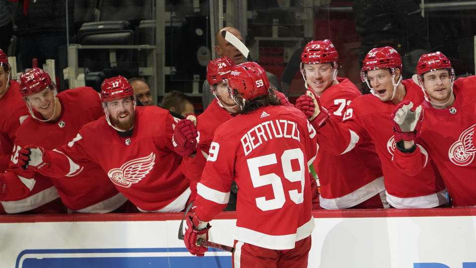 Detroit Red Wings left wing Tyler Bertuzzi (59) celebrates his goal against the Tampa Bay Lightning in the second period of an NHL hockey game Thursday, Oct. 14, 2021, in Detroit. (AP Photo/Paul Sancya)