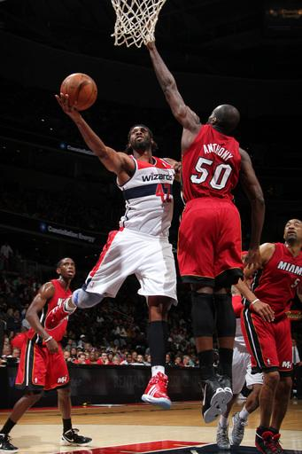 Big 3 watches as Heat lose to Wizards 104-70